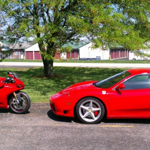 Duc Indy's demo bike and customers car when I pulled up...